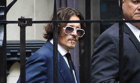 Actor Johnny Depp leaves the High Court in London, Tuesday, July 7, 2020. (AP)