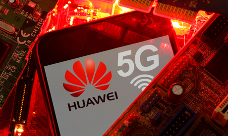 FILE PHOTO: A smartphone with the Huawei and 5G network logo is seen on a PC motherboard in this ill