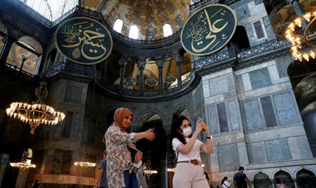 FILE PHOTO: People pose for a selfie as they visit the Hagia Sophia or Ayasofya, a UNESCO World Heri