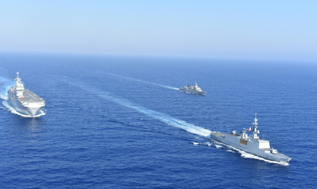 Greek and French vessels sail in formation during a joint military exercise in Mediterranean sea, in