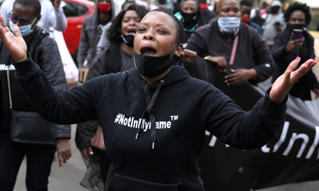 Protesters chant slogans during a protest against President Emmerson Mnangagwa