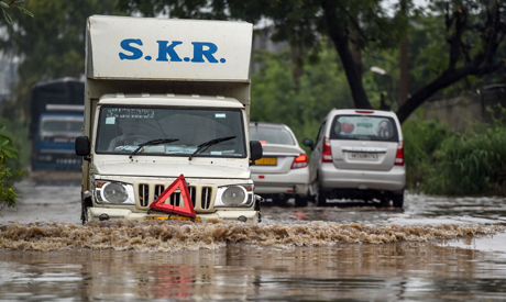 Vehicles wade on a flooded road following monsoon rainfall in Gurgaon on August 20, 2020.  AFP