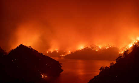 Flames surround Lake Berryessa during the LNU Lightning Complex fire in Napa, California on August 1