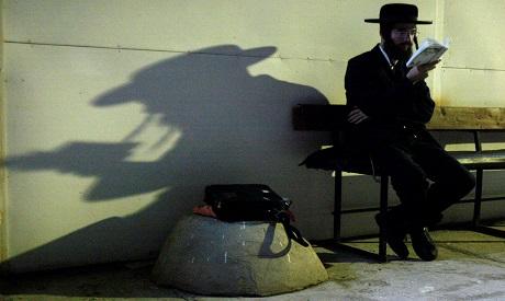 An ultra-Orthodox Jewish man prays