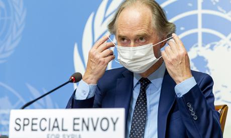 Geir O. Pedersen, UN Special Envoy for Syria, wears a face mask as he speaks to the media regarding