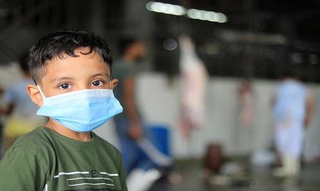 An Egyptian boy wears a protective mask