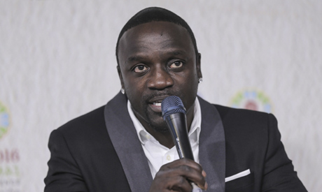 File photo, Akon, international music star and co-founder of Akon Lighting Africa, speaks at a news