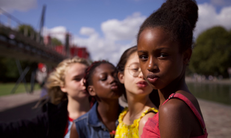 """FILE - This image released by Netflix shows the cast of the coming-of-age film """"Cuties."""" The backlas"""