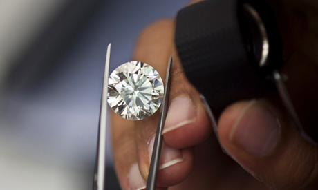 FILE PHOTO: A trader inspects a diamond during a show at the trading floor of Israel