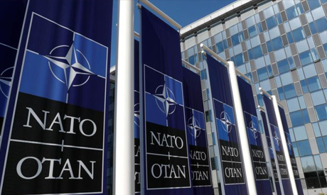 FILE PHOTO: Banners displaying the NATO logo are placed at the entrance of new NATO headquarters dur