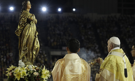 FILE - In this Nov. 21, 2019 file photo, Pope Francis blesses a statue of the Mother Mary as he cele