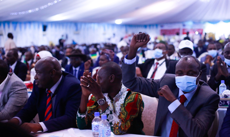 Political leaders cheer during the singing of the Sudan peace deal with the rebel in Juba, South Sud