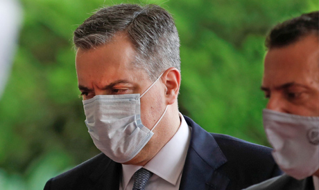 Lebanese Prime Minister Mustapha Adib, wearing a protective face masks, arrives to meet with the Fre