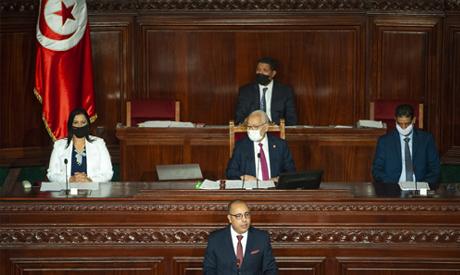 Tunisian designated Prime Minister Hichem Mechichi, center below, delivers his speech at the parliam