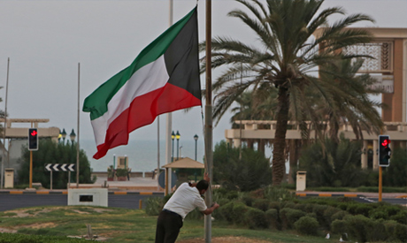 The Kuwaiti flag is lowered to half-mast outside the Dasman Diabetes Institute in Kuwait City on Sep