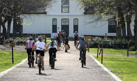 Local tourists are seen during an adventure e-bike tour, run by tour operator Raino Bolz, on the Bos