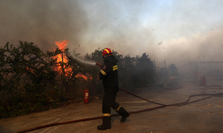 A firefighter operates during a wildfire in Kalyvia, southeast of Athens, on Wednesday, Sept. 9, 202