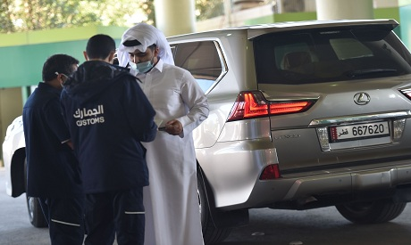 Saudi customs officers checking the documents of a Qatari visitor