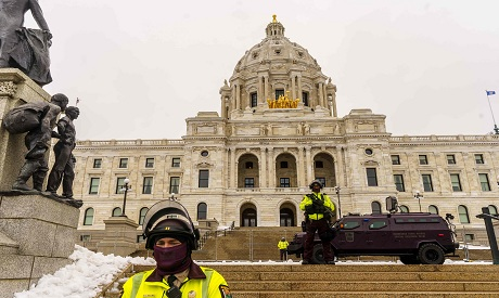 Police Officers stand guard outside the Capitol building Minnesota. AFP