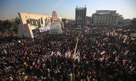 Iraqi demonstrators lift flags