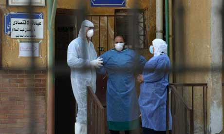 File photo: Medical staff members at the infectious diseases unit of the Imbaba hospital in Cairo ga