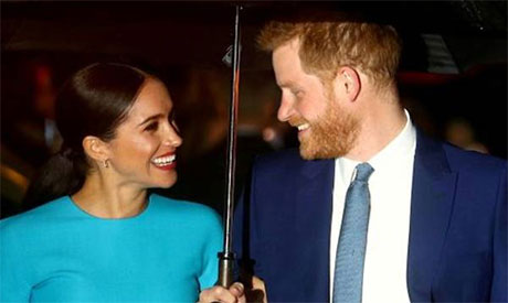 Prince Harry and his wife Meghan