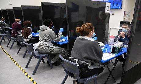 UK Health workers assist as students take coronavirus disease (COVID-19) tests. REUTERS