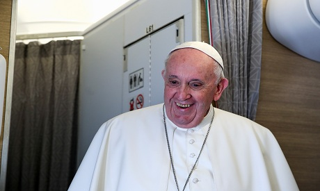 Pope Francis gives a news conference aboard the plane after visiting Iraq  REUTERS