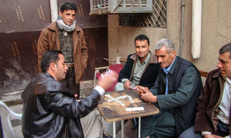 Playing games at a coffee shop in Iraq