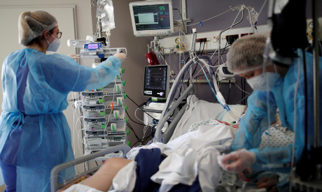 Medical staff work in the Intensive Care Unit in Paris
