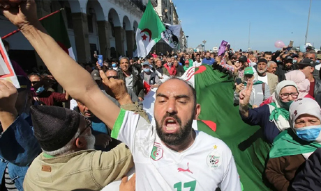 A demonstrator gestures during a protest demanding political change, in Algiers. REUTERS
