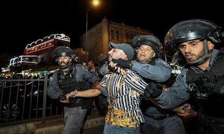 Israeli police detain a man outside Damascus Gate in Jerusalem