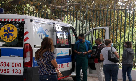 People wait to get tested for the coronavirus disease in Tunis