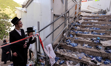 Ultra Orthodox Jews look at stairs with waste on it in Mount Meron, northern Israel, where fatalitie