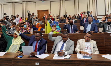 Somalia legislators vote by rising their hands to cancel a divisive two-year presidential term exten