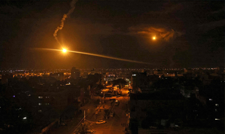 An flare fired by Israeli forces lights the sky above the town of Rafah, in the southern Gaza Strip
