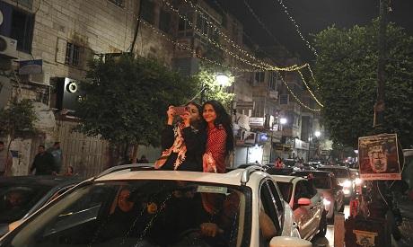 Palestinians celebrate in Ramallah AFP