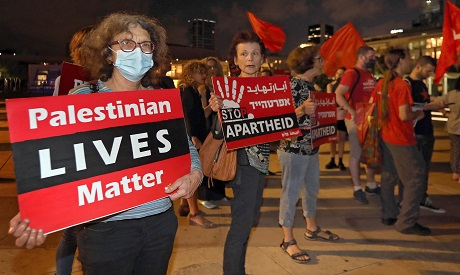 Israeli left-wing activists take part in a demonstration in Tel Aviv in support of the Palestinians.