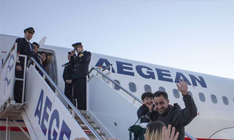 Asylum-seekers board a flight from Athens to Luxembourg. Photo UNHCR