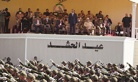 A handout picture released by the Hashed al-Shaabi force shows Iraqi Prime Minister Mustafa al-Kadhe