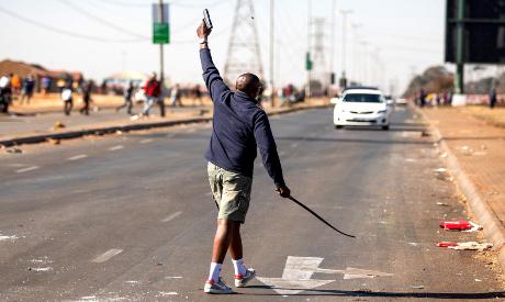 A man fires a hand gun in South Africa