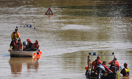 Rescue boats patrol on a flooded area of the federal highway B265 in Erftstadt, western Germany, on