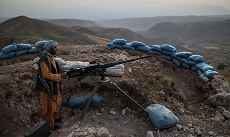 In this picture taken on July 11, 2021 an Afghan militia fighter keeps a watch at an outpost against