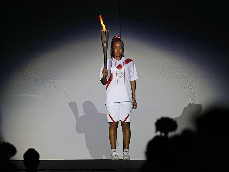 Japan s Naomi Osaka holds the Olympic torch during the opening ceremony in the Olympic Stadium at th