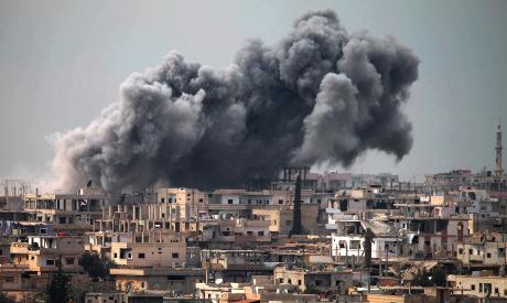 Smoke billows following reported air strikes in Daraa