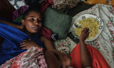 An injured female soldier of Tigray Defence Forces (TDF) lays at the entrance hall of Ayder Referral