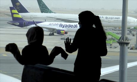 Passengers watch aircraft as they wait for their flight at King Abdulaziz International Airport in J