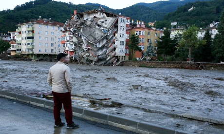 flood waters sweep by in Bozk, Turkeyrt town
