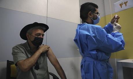 Iranian receiving vaccination