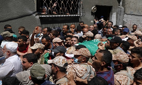Palestinians mourning after protests